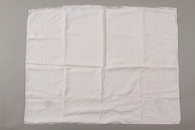 2012.342.5 front White pillowcase with lace and an MS monogram returned to Czech Jewish concentration camp inmates postwar