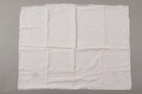 2012.342.5 front White pillowcase with lace and an MS monogram returned to Czech Jewish concentration camp inmates postwar  Click to enlarge