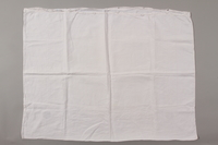 2012.342.5 back White pillowcase with lace and an MS monogram returned to Czech Jewish concentration camp inmates postwar  Click to enlarge
