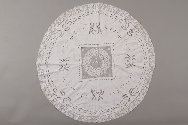 2012.342.6 front Circular white tablecloth saved by a by Czech Jewish refugee