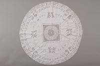 2012.342.6 front Circular white tablecloth saved by a by Czech Jewish refugee  Click to enlarge