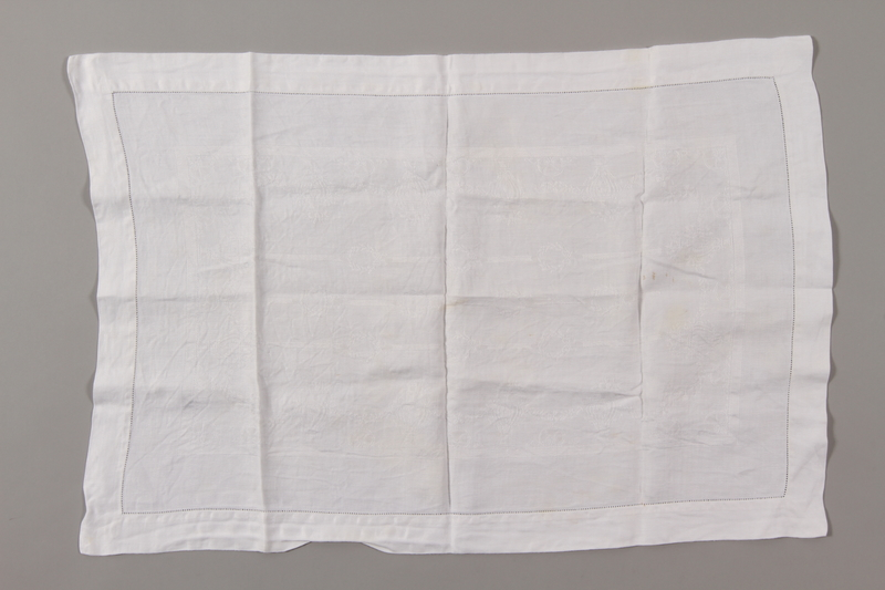 2012.342.7 front Rectangular white tablecloth saved by a by Czech Jewish refugee