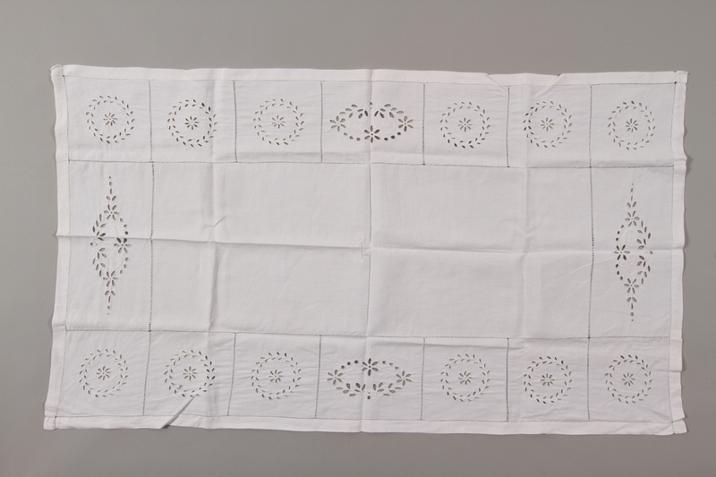 2012.342.8 front White cotton tablecloth with floral motifs saved by a by Czech Jewish refugee