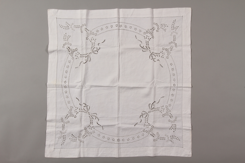 2012.342.9 front Square white tablecloth with floral motifs saved by a by Czech Jewish refugee