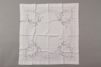2012.342.9 front Square white tablecloth with floral motifs saved by a by Czech Jewish refugee  Click to enlarge