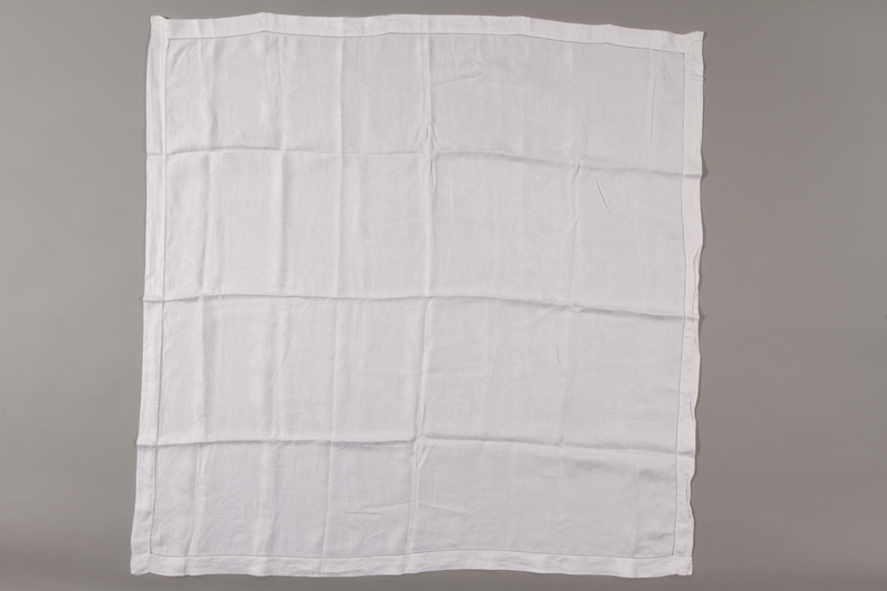 2012.342.11 front Square white cotton tablecloth saved by a by Czech Jewish refugee