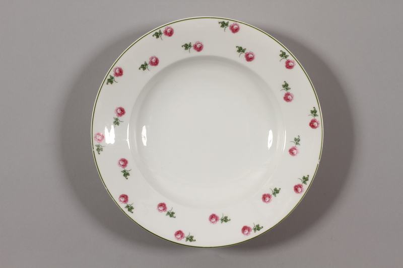 2015.365.3 front China plate with floral  border recovered by a German Jewish family postwar