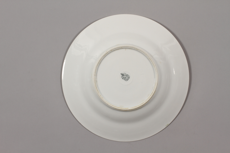 2015.365.3 back China plate with floral  border recovered by a German Jewish family postwar