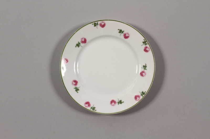 2015.365.4 front China plate with floral  border recovered by a German Jewish family postwar