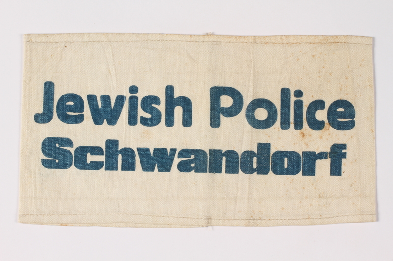 2009.401.3 front Armband stamped Jewish Police Schwandorf acquired by a US soldier