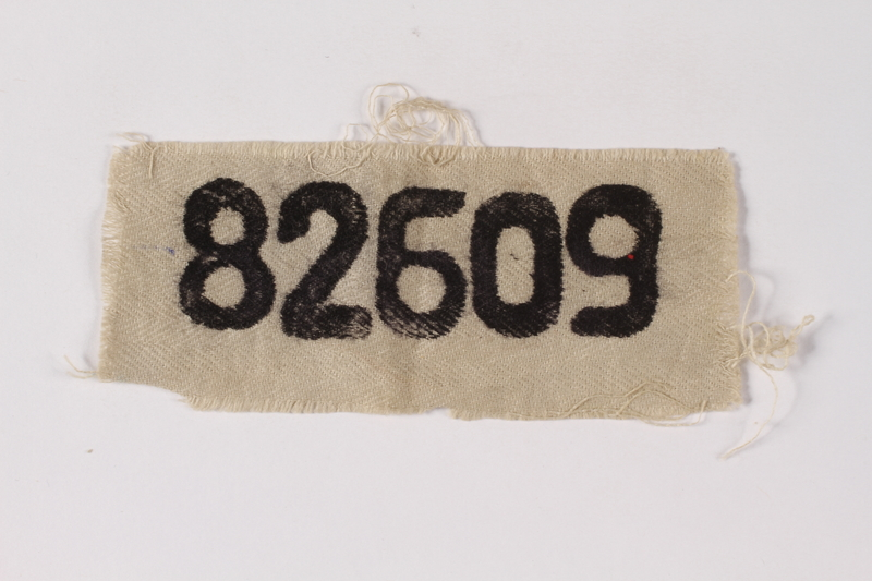 1995.A.0274.2 front White patch with prisoner number 82609 worn by German Jewish inmate
