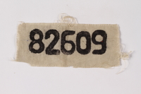 1995.A.0274.2 front White patch with prisoner number 82609 worn by German Jewish inmate  Click to enlarge