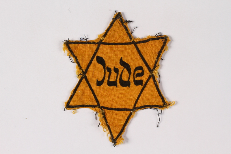 2001.3.5 front Star of David badge printed Jude owned by a Czech Jewish survivor