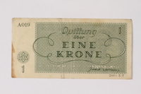 2001.3.7 back Theresienstadt ghetto-labor camp scrip, 1 krone, owned by a former Czech Jewish inmate  Click to enlarge