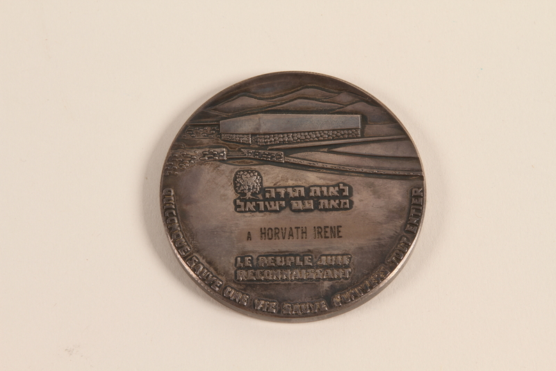 1994.111.1.1 back Righteous Among the Nations medal awarded to a Hungarian rescuer