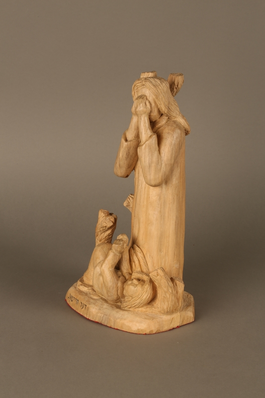 2016.111.1 left side Wooden sculpture of a grieving woman made by a Lithuanian Jewish artist