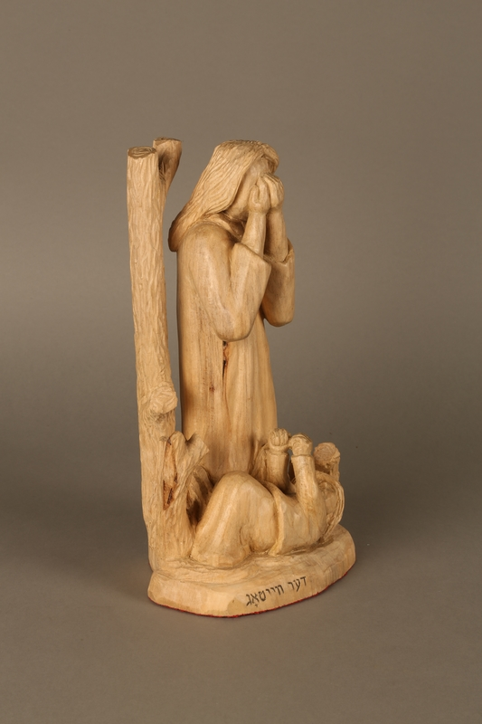 2016.111.1 right side Wooden sculpture of a grieving woman made by a Lithuanian Jewish artist