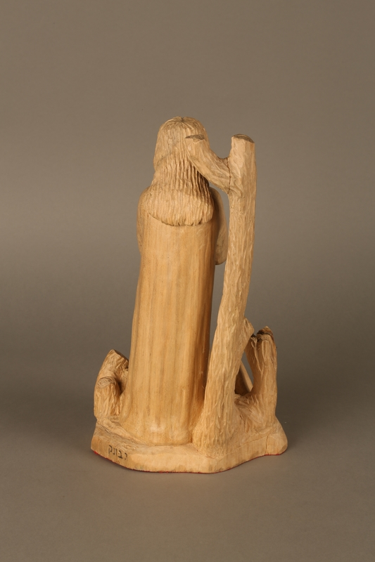 2016.111.1 back Wooden sculpture of a grieving woman made by a Lithuanian Jewish artist