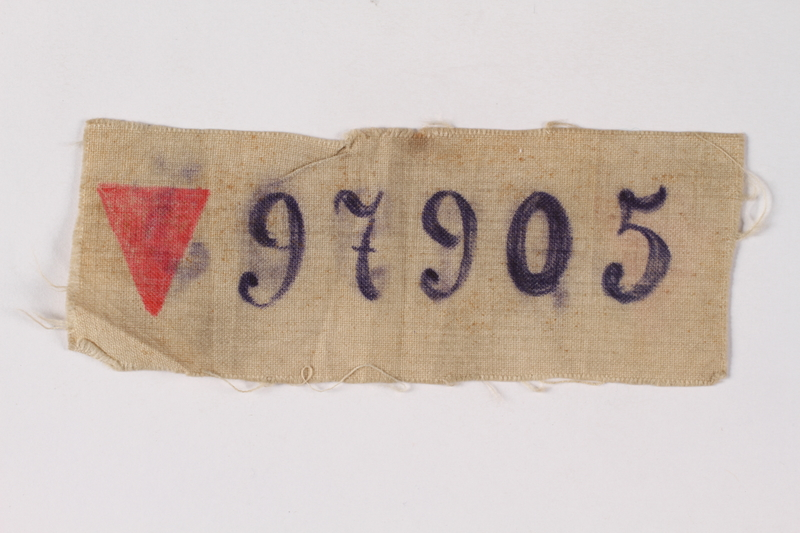 1995.A.0753.2 front White prison patch with a red triangle and number 97905 owned by a Lithuanian Jewish man