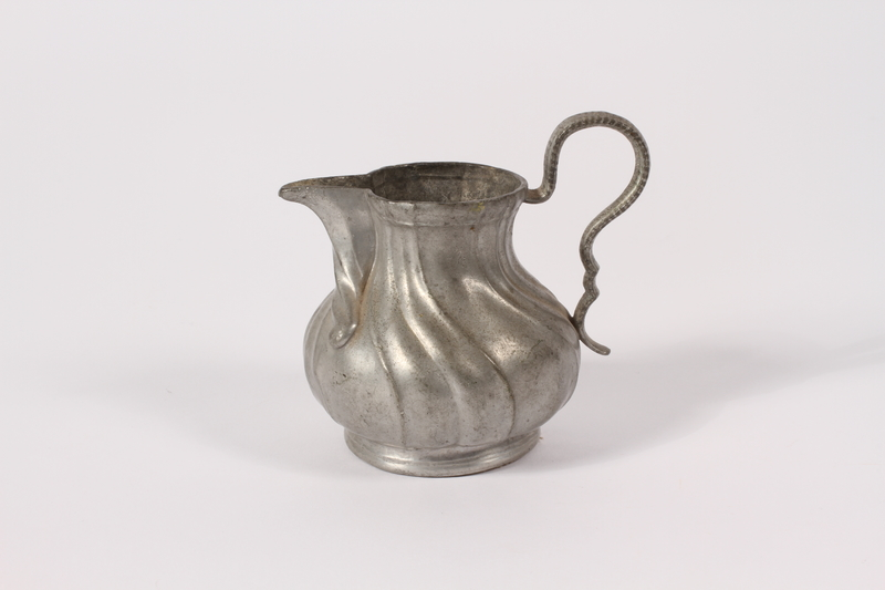 2015.451.45 front Pewter creamer acquired by an UNRRA aid worker