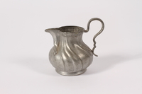 2015.451.45 front Pewter creamer acquired by an UNRRA aid worker  Click to enlarge