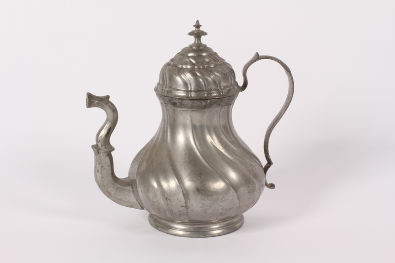 2015.451.46 front Pewter teapot acquired by an UNRRA aid worker
