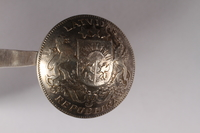 2015.451.47 bottom Spoon made from a Latvian coin  Click to enlarge