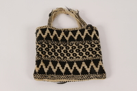 2000.471.2 back Black and white knit bag used in slave labor camps by a Polish Jewish woman  Click to enlarge