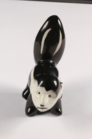 2015.238.17 front Ceramic figurine of a skunk with Adolf Hitler's face  Click to enlarge