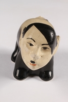 2015.238.18 a front Ceramic figurine of a skunk with Adolf Hitler's face  Click to enlarge