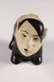 Ceramic figurine of a skunk with Adolf Hitler's face