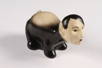 2015.238.18 a right side Ceramic figurine of a skunk with Adolf Hitler's face  Click to enlarge