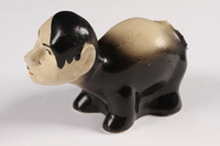 2015.238.18 a left side Ceramic figurine of a skunk with Adolf Hitler's face  Click to enlarge