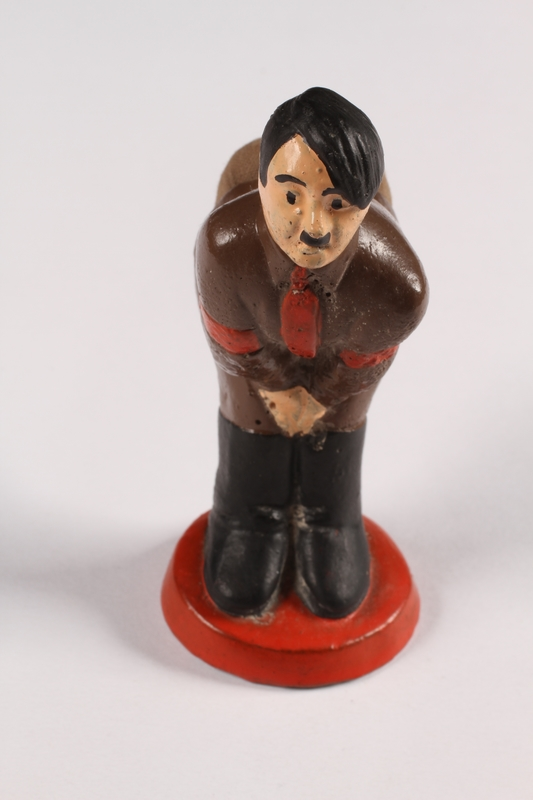 2015.238.19 a front Ceramic figurine of Adolf Hitler with pincushion