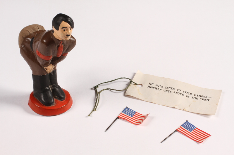 2015.238.19 a-d overall view Ceramic figurine of Adolf Hitler with pincushion