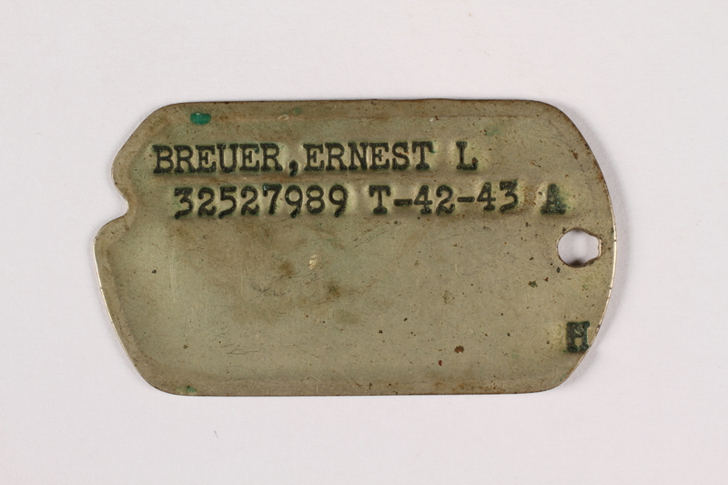 2015.473.2 a front Two dogs tags and chain worn by an Austrian American soldier