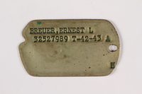 2015.473.2 a front Two dogs tags and chain worn by an Austrian American soldier  Click to enlarge