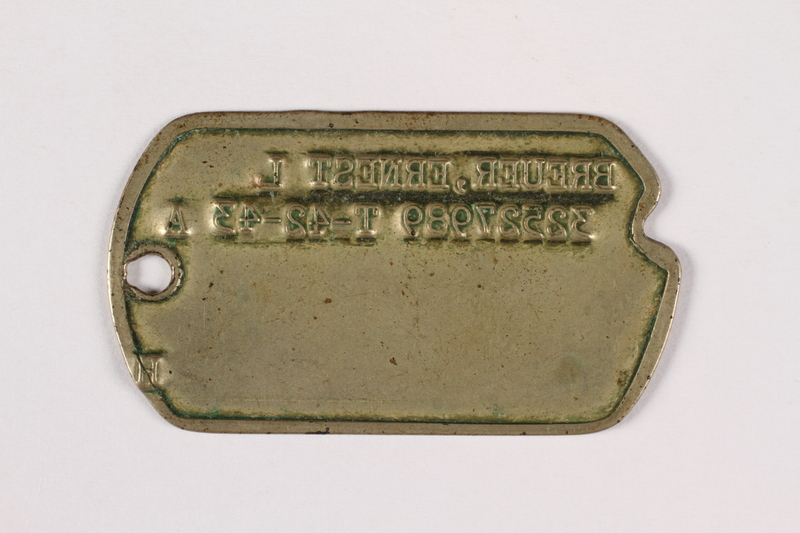2015.473.2 a back Two dogs tags and chain worn by an Austrian American soldier