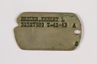 2015.473.2 b front Two dogs tags and chain worn by an Austrian American soldier  Click to enlarge