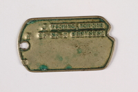 2015.473.2 b back Two dogs tags and chain worn by an Austrian American soldier  Click to enlarge
