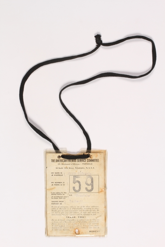 2000.228.2 front American Friends Service Committee ID badge worn by a rescued Jewish child