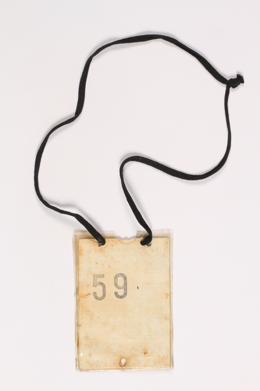 2000.228.2 back American Friends Service Committee ID badge worn by a rescued Jewish child