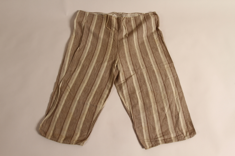 2015.509.2b front Boy's brown striped suit recovered postwar by his parents