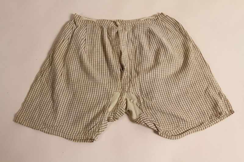 2015.509.3 front Boy's brown checked pants recovered postwar by his parents