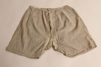 2015.509.3 front Boy's brown checked pants recovered postwar by his parents  Click to enlarge