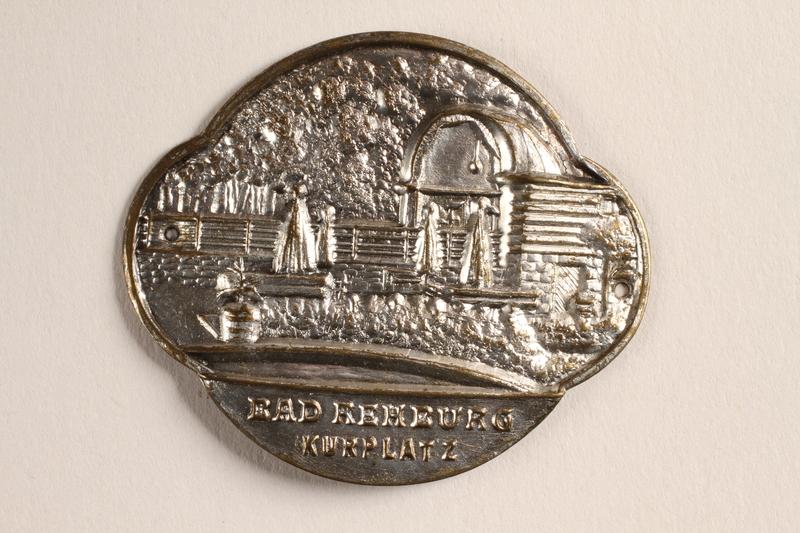 2004.614.7 front Metal token depicting the Bad Rehburg Kurplatz