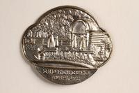 2004.614.7 front Metal token depicting the Bad Rehburg Kurplatz  Click to enlarge