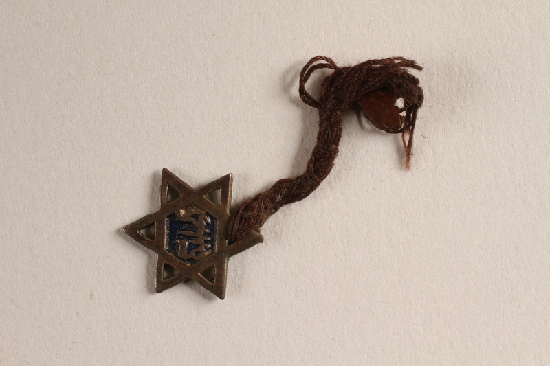 2004.614.8 front Metal and enamel Star of David