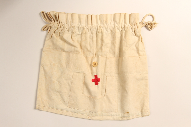 2004.614.19 front Drawstring pouch embroidered with the Red Cross symbol