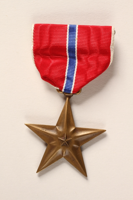 2015.255.2 a front Bronze Star medal with box and certificate awarded to a Jewish American soldier